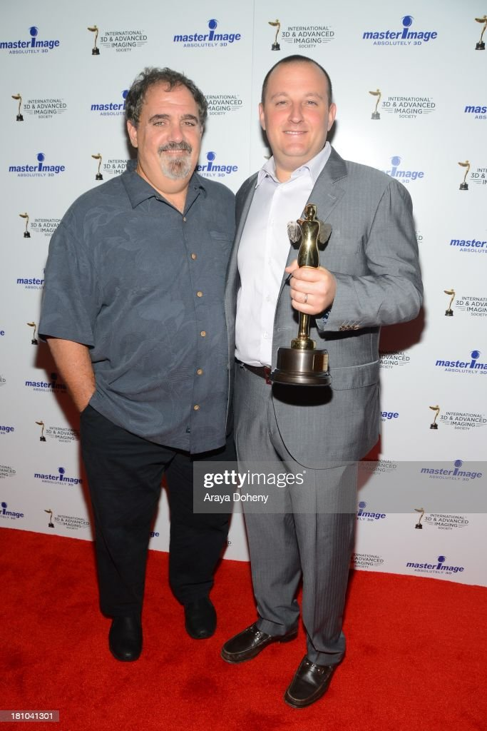 Jon Landau and William Sherak receive an award at the International 3D Society & Advanced Imaging Society 3D Products of the Year Awards at Paramount Studios on September 18, 2013 in Hollywood, California.