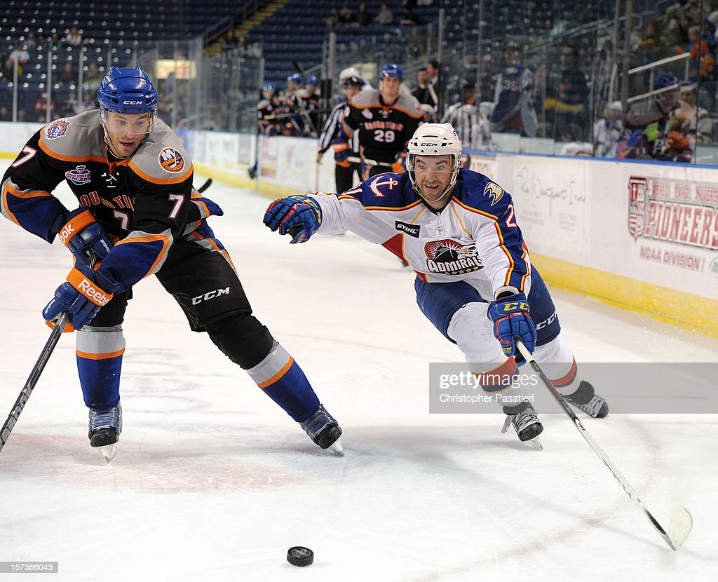 Jon Landry #7 of the Bridgeport Sound Tigers and Kyle Palmieri #21 of the Norfolk Admirals skate for the puck during an American Hockey League game on December 2, 2012 at the Webster Bank Arena in Bridgeport, Connecticut. The Admirals defeated the Sound Tigers 4-1.