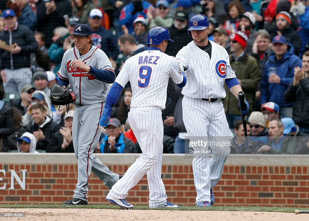 <a gi-track='captionPersonalityLinkClicked' href=/galleries/search?phrase=Jon+Lester&family=editorial&specificpeople=832746 ng-click='$event.stopPropagation()'>Jon Lester</a> #34 congratulates teammate Javier Baez #9 of the Chicago Cubs after Baez scored a run in the fifth inning against the Atlanta Braves at Wrigley Field on April 29, 2016 in Chicago, Illinois.