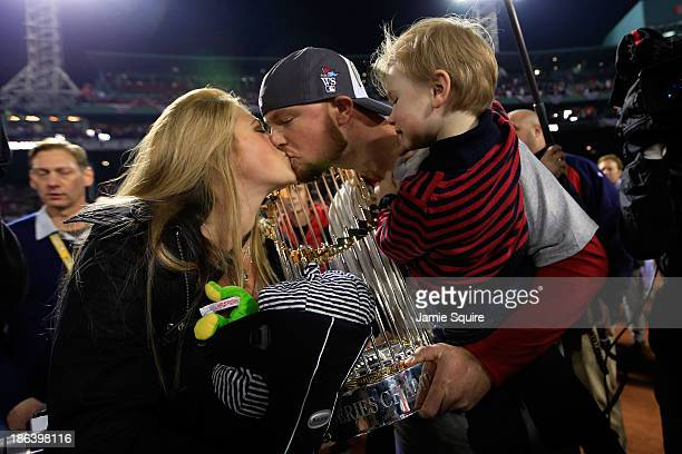 Jon Lester of the Boston Red Sox celebrates with his son Hudson and wife Farrah Stone Johnson after defeating the St Louis Cardinals 61 in Game Six...