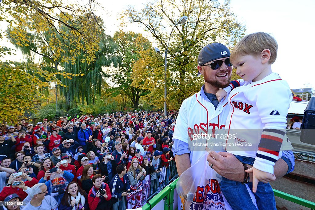 <a gi-track='captionPersonalityLinkClicked' href=/galleries/search?phrase=Jon+Lester&family=editorial&specificpeople=832746 ng-click='$event.stopPropagation()'>Jon Lester</a> #31 of the Boston Red Sox enjoys a victory parade with his son Hudson on November 2, 2013 through Boston, Massachusetts.