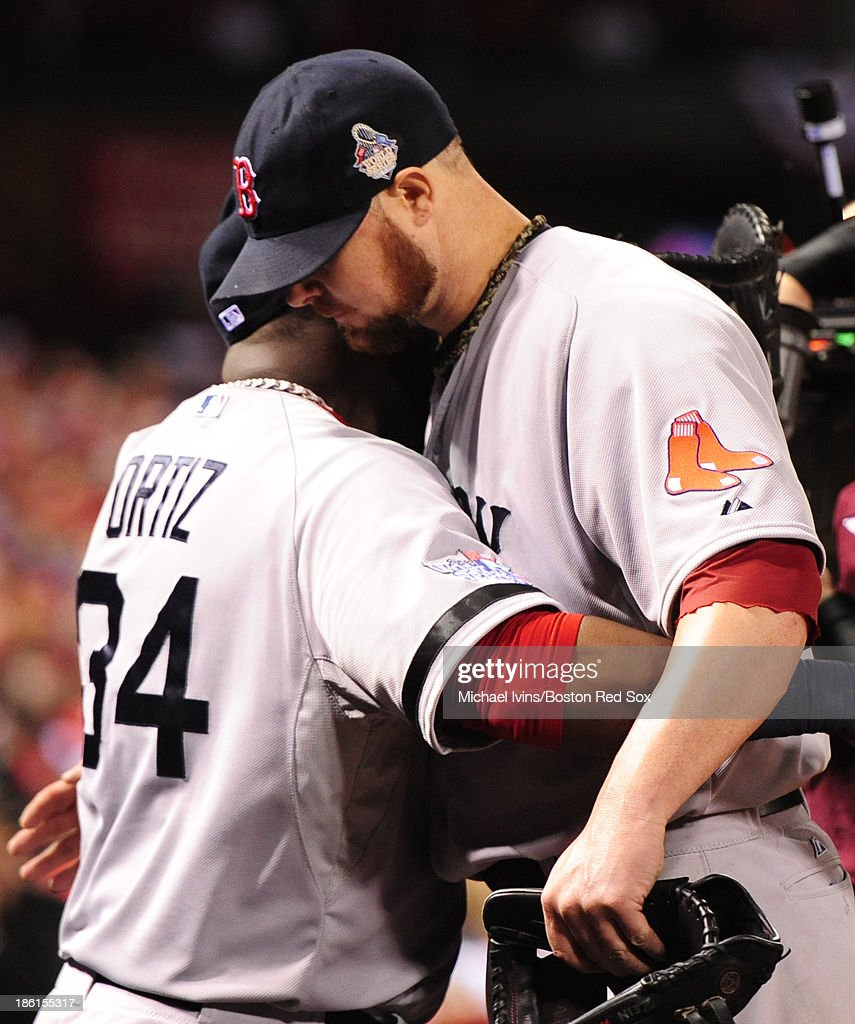 Jon Lester #31 of the Boston Red Sox hugs David Ortiz #34 after being removed from the game against the St. Louis Cardinals in the eighth inning of Game Five of the 2013 World Series on October 28, 2013 at Busch Stadium in St. Louis, Missouri.