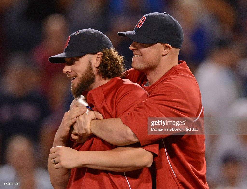 <a gi-track='captionPersonalityLinkClicked' href=/galleries/search?phrase=Jon+Lester&family=editorial&specificpeople=832746 ng-click='$event.stopPropagation()'>Jon Lester</a> #31 of the Boston Red Sox hugs <a gi-track='captionPersonalityLinkClicked' href=/galleries/search?phrase=Jarrod+Saltalamacchia&family=editorial&specificpeople=836404 ng-click='$event.stopPropagation()'>Jarrod Saltalamacchia</a> #39 after the Red Sox defeated the Detroit Tigers 20-4 on September 4, 2013 at Fenway Park in Boston Massachusetts.