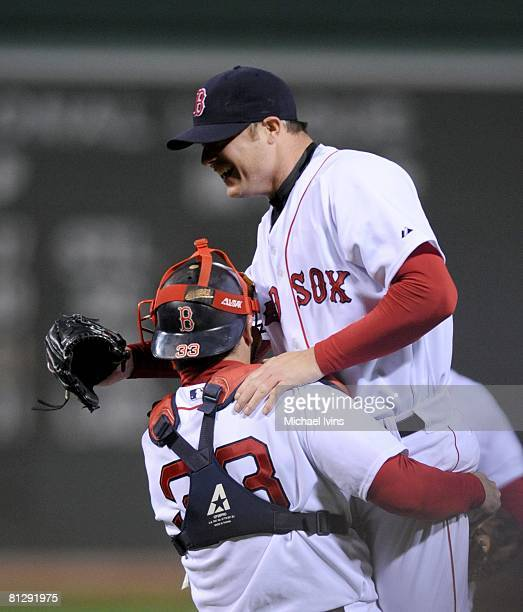 Jon Lester of the Boston Red Sox is hoisted by catcher Jason Varitek after pitching a nohitter against the Kansas City Royals at Fenway Park in...