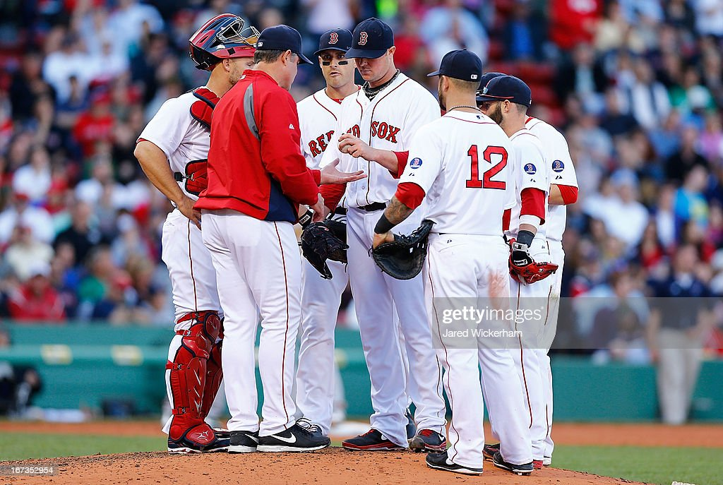 Jon Lester #31 of the Boston Red Sox is pulled from the game by manager John Farrell #53 during the game in the sixth inning against the Oakland Athletics on April 24, 2013 at Fenway Park in Boston, Massachusetts.