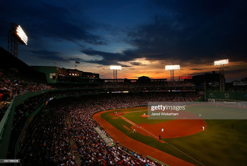 Jon Lester #31 of the Boston Red Sox pitches against the Minnesota Twins in the fourth inning as the sun sets over Fenway Park on June 17, 2014 in Boston, Massachusetts.