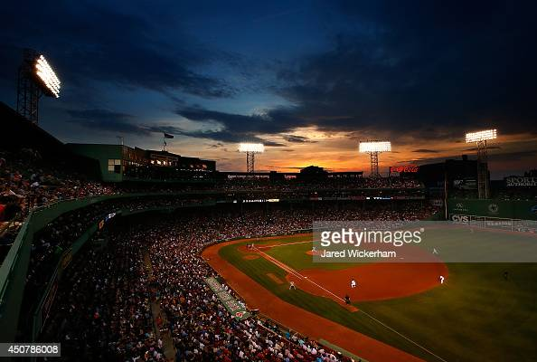 Jon Lester of the Boston Red Sox pitches against the Minnesota Twins in the fourth inning as the sun sets over Fenway Park on June 17 2014 in Boston...