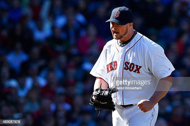 Jon Lester of the Boston Red Sox reacts after getting out of the 6th inning against the Milwaukee Brewers during the game at Fenway Park on April 6...