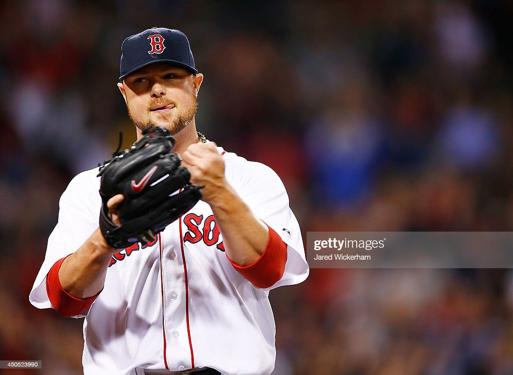 Jon Lester #31 of the Boston Red Sox reacts following a double play to end the seventh inning against the Cleveland Indians during the game at Fenway Park on June 12, 2014 in Boston, Massachusetts.