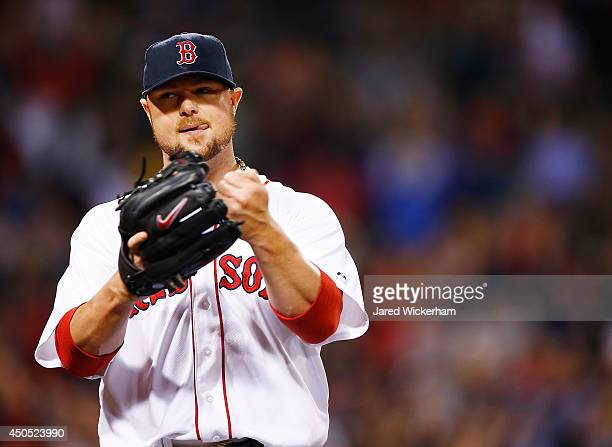 Jon Lester of the Boston Red Sox reacts following a double play to end the seventh inning against the Cleveland Indians during the game at Fenway...