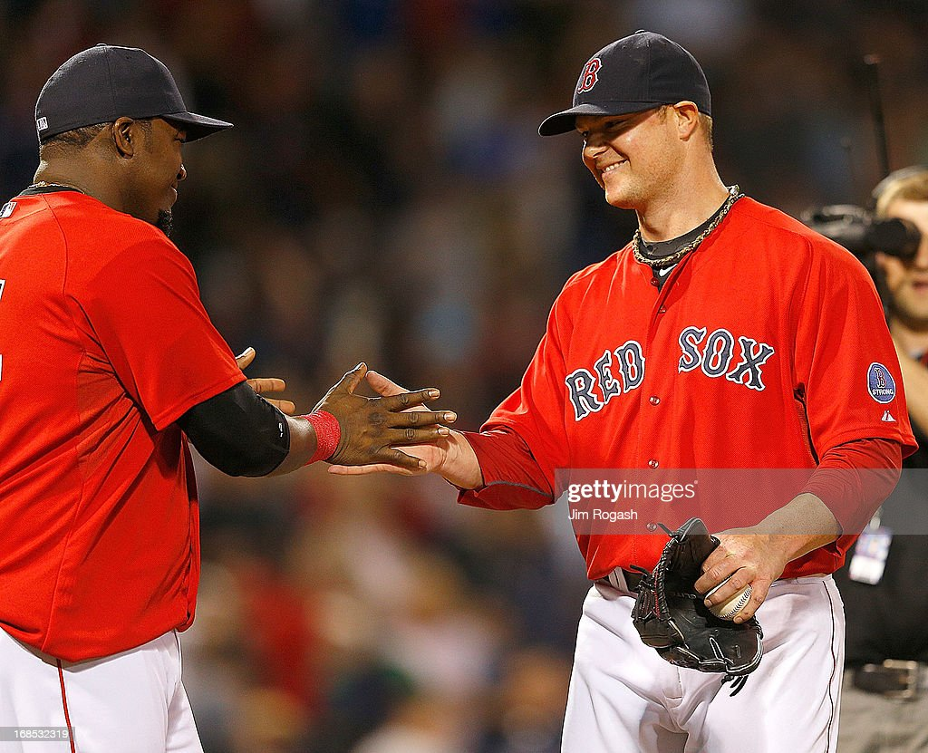 <a gi-track='captionPersonalityLinkClicked' href=/galleries/search?phrase=Jon+Lester&family=editorial&specificpeople=832746 ng-click='$event.stopPropagation()'>Jon Lester</a> #31 of the Boston Red Sox reacts with <a gi-track='captionPersonalityLinkClicked' href=/galleries/search?phrase=David+Ortiz&family=editorial&specificpeople=175825 ng-click='$event.stopPropagation()'>David Ortiz</a> #34 after throwing a one-hit shutout against the Toronto Blue Jays at Fenway Park on May 10, 2013 in Boston, Massachusetts.