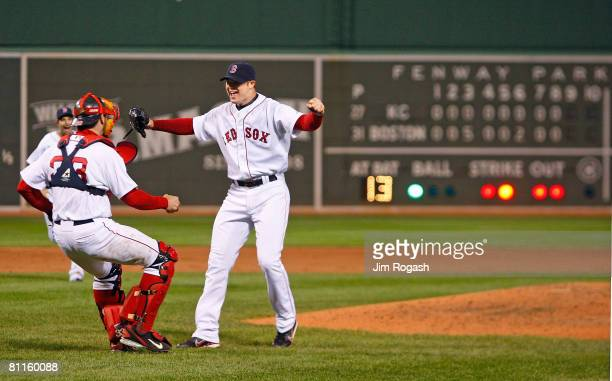 Jon Lester of the Boston Red Sox reacts with teammate Jason Varitek after throwing a no hitter against the Kansas City Royals at Fenway Park on May...