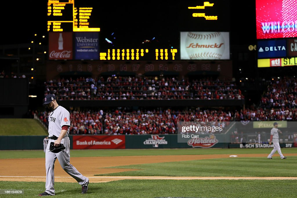 Jon Lester #31 of the Boston Red Sox returns to the dugout after being removed from the game in the eighth inning against the St. Louis Cardinals during Game Five of the 2013 World Series at Busch Stadium on October 28, 2013 in St Louis, Missouri.
