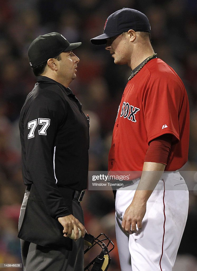 Jon Lester #31 of the Boston Red Sox talks with umpire Jim Reynolds #77 after the third inning of the game against the Baltimore Orioles at Fenway Park on May 4, 2012 in Boston, Massachusetts.
