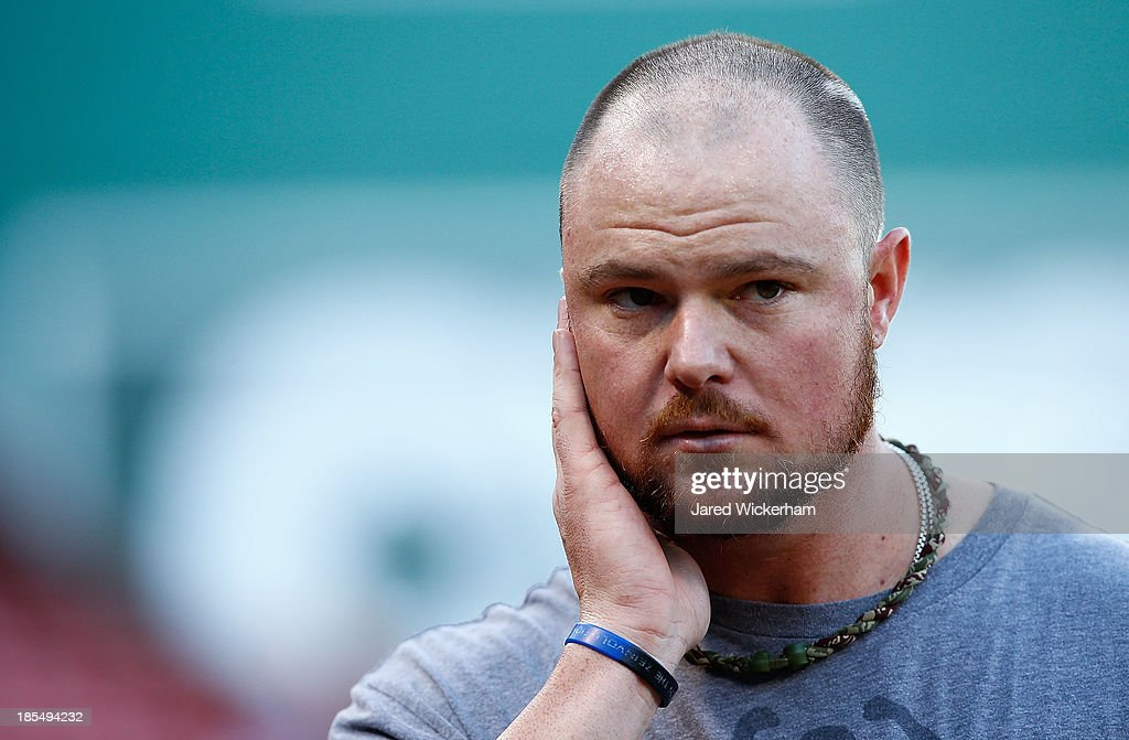 <a gi-track='captionPersonalityLinkClicked' href=/galleries/search?phrase=Jon+Lester&family=editorial&specificpeople=832746 ng-click='$event.stopPropagation()'>Jon Lester</a> #31 of the Boston Red Sox, the starting pitcher for game one of the World Series, watches his teammates take batting practice during the workout prior to the start of the World Series on October 21, 2013 at Fenway Park in Boston, Massachusetts.