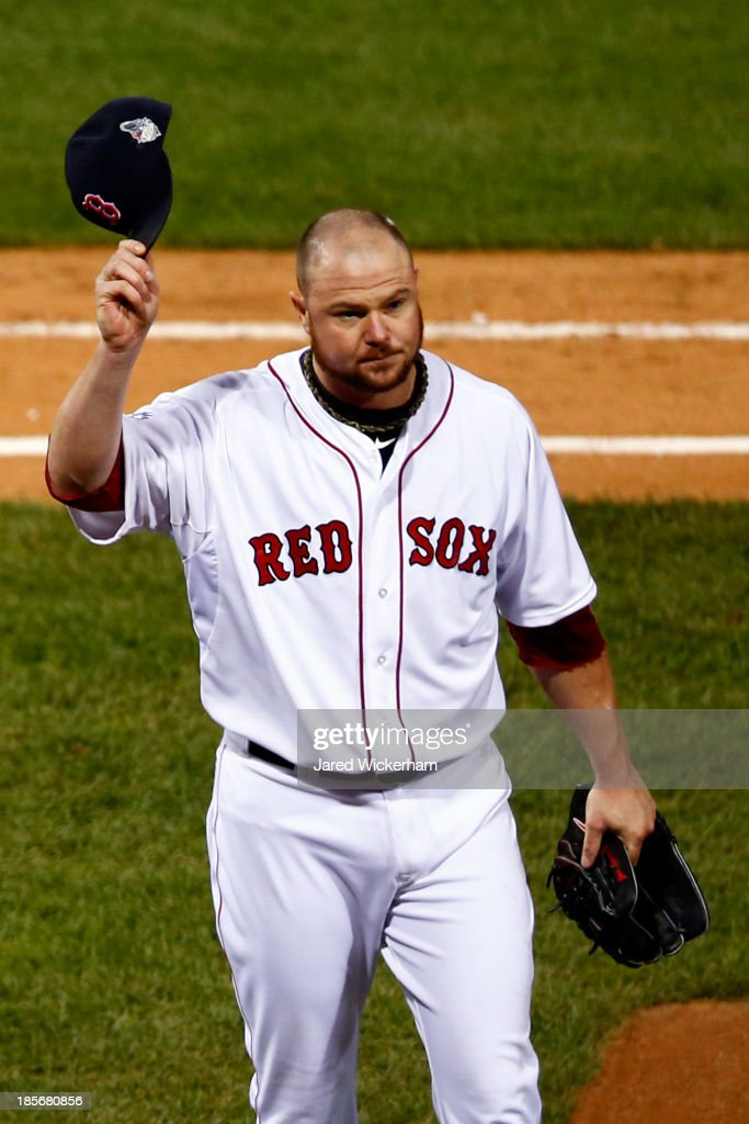 <a gi-track='captionPersonalityLinkClicked' href=/galleries/search?phrase=Jon+Lester&family=editorial&specificpeople=832746 ng-click='$event.stopPropagation()'>Jon Lester</a> #31 of the Boston Red Sox tips his cap as he leaves the game in the eighth inning against the St. Louis Cardinals during Game One of the 2013 World Series at Fenway Park on October 23, 2013 in Boston, Massachusetts.