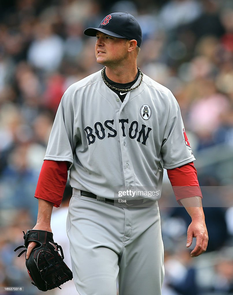 Jon Lester #31 of the Boston Red Sox walks off the field after the first inning against the New York Yankees during Opening Day on April 1, 2013 at Yankee Stadium in the Bronx borough of New York City.