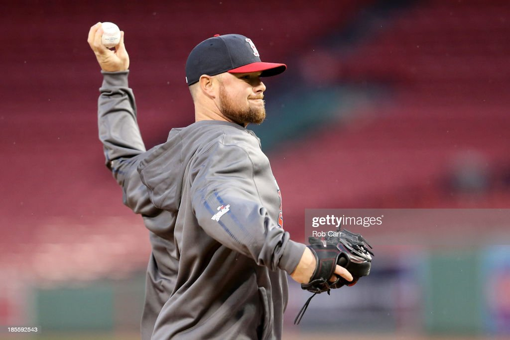Jon Lester #31 of the Boston Red Sox warms up during team workout in the 2013 World Series Media Day at Fenway Park on October 22, 2013 in Boston, Massachusetts. The Red Sox host the Cardinals in Game 1 on October 23, 2013.