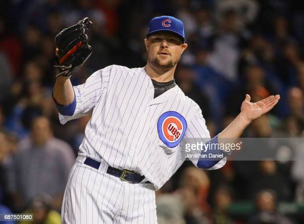 Jon Lester of the Chicago Cubs celebrates a complete game win against the San Francisco Giants at Wrigley Field on May 23 2017 in Chicago Illinois...