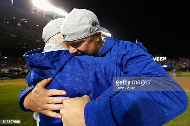 Jon Lester of the Chicago Cubs celebrates with manager Joe Maddon after defeating the Los Angeles Dodgers 50 in game six of the National League...
