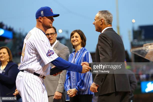 Jon Lester of the Chicago Cubs is greeted by Commissioner of Baseball Robert D Manfred Jr during the World Series ring ceremony ahead of the game...