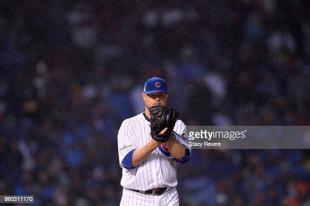 Jon Lester of the Chicago Cubs pitches in the eighth inning during game four of the National League Division Series against the Washington Nationals...