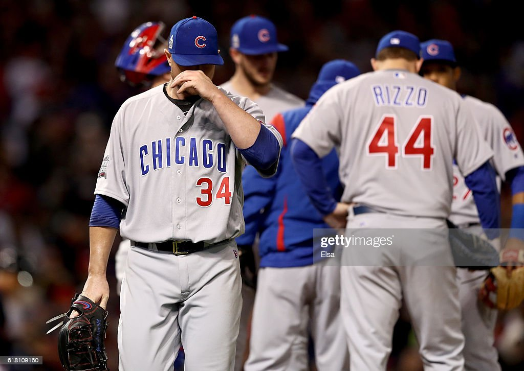 Jon Lester #34 of the Chicago Cubs reacts after being relieved during the sixth inning in Game One of the 2016 World Series against the Cleveland Indians at Progressive Field on October 25, 2016 in Cleveland, Ohio.