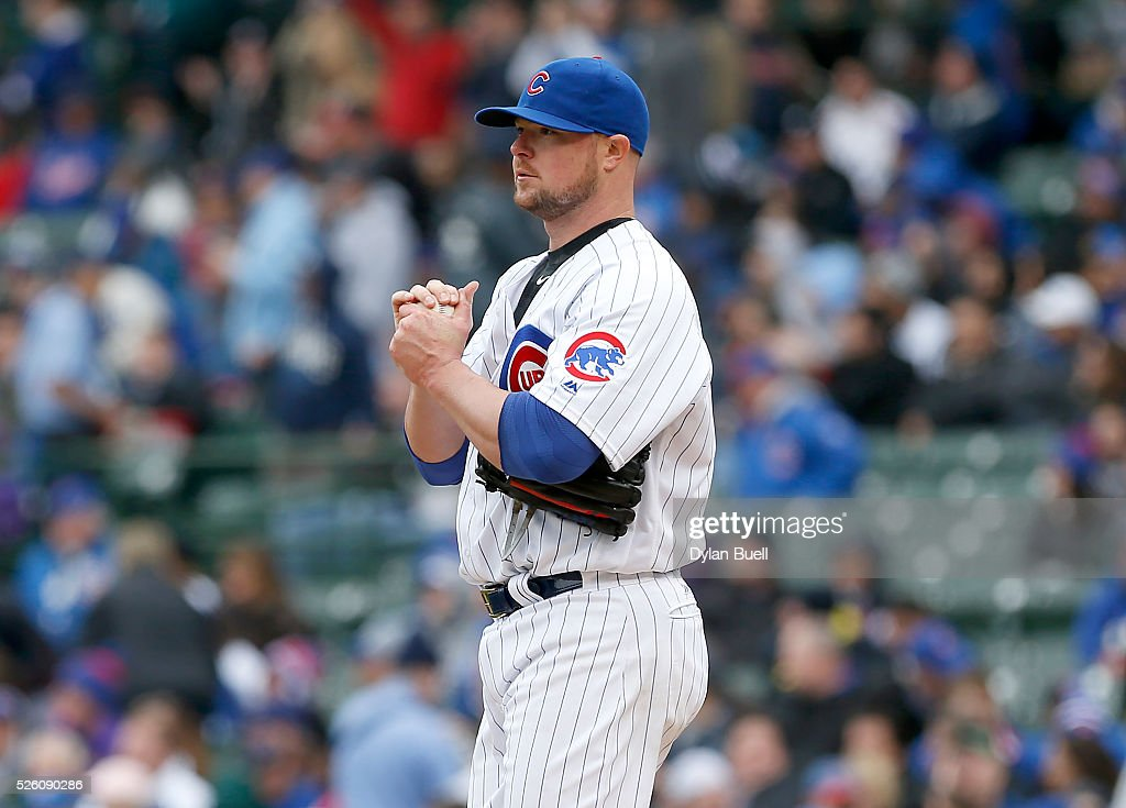 <a gi-track='captionPersonalityLinkClicked' href=/galleries/search?phrase=Jon+Lester&family=editorial&specificpeople=832746 ng-click='$event.stopPropagation()'>Jon Lester</a> #34 of the Chicago Cubs reacts after giving up a home run in the fourth inning against the Atlanta Braves at Wrigley Field on April 29, 2016 in Chicago, Illinois.