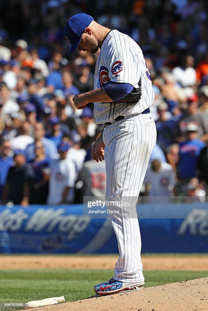 Jon Lester #34 of the Chicago Cubs reacts after giving up a solo home run in the 7th inning to Hunter Pence of the San Francisco Giants at Wrigley Field on September 2, 2016 in Chicago, Illinois.