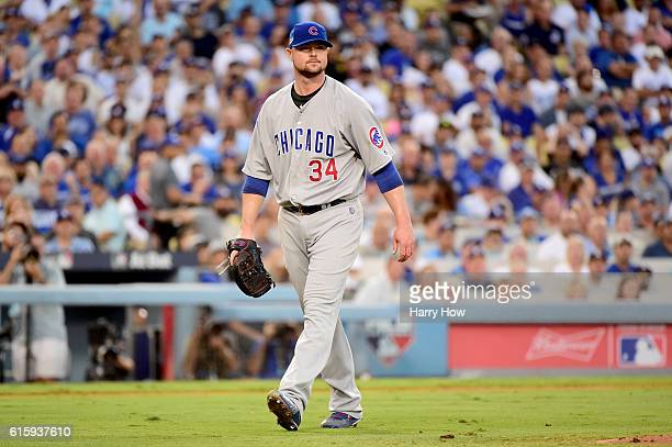 Jon Lester of the Chicago Cubs reacts after the final out of the second inning aginst Los Angeles Dodgers in game five of the National League...