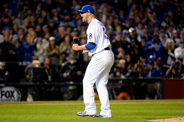 Jon Lester of the Chicago Cubs reacts to getting the final out of the fourth inning during Game 1 of NLDS against the San Francisco Giants at Wrigley...