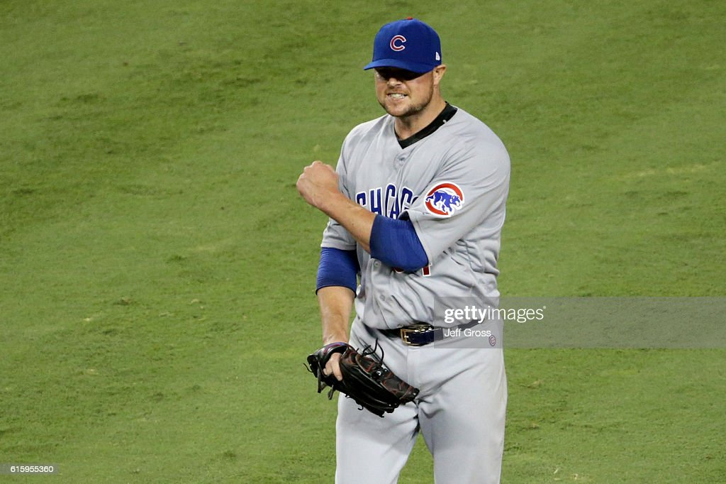 Jon Lester #34 of the Chicago Cubs reacts while taking on the Los Angeles Dodgers in game five of the National League Division Series at Dodger Stadium on October 20, 2016 in Los Angeles, California.