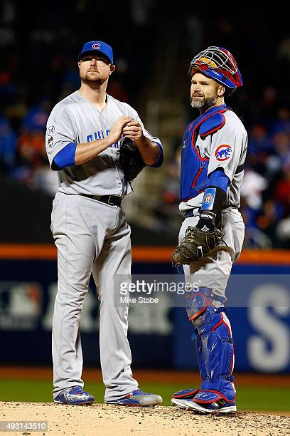 Jon Lester of the Chicago Cubs talks with David Ross on the mound in the sixth inning against the New York Mets during game one of the 2015 MLB...