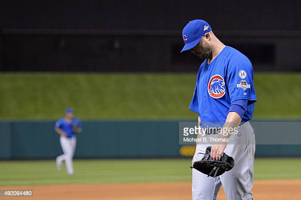 Jon Lester of the Chicago Cubs walks off the field as he is relieved in the eighth inning against the St Louis Cardinals during game one of the...