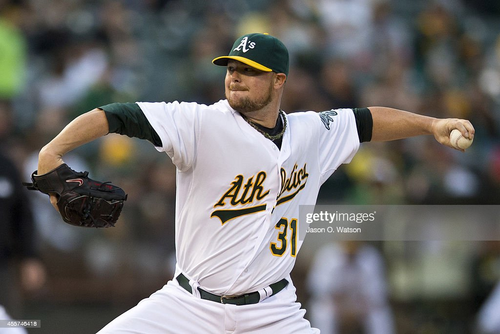 <a gi-track='captionPersonalityLinkClicked' href=/galleries/search?phrase=Jon+Lester&family=editorial&specificpeople=832746 ng-click='$event.stopPropagation()'>Jon Lester</a> #31 of the Oakland Athletics pitches against the Philadelphia Phillies during the first inning of an interleague game at O.co Coliseum on September 19, 2014 in Oakland, California.