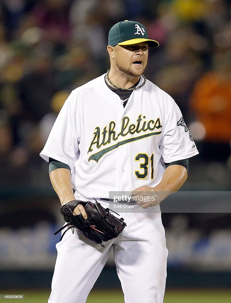 <a gi-track='captionPersonalityLinkClicked' href=/galleries/search?phrase=Jon+Lester&family=editorial&specificpeople=832746 ng-click='$event.stopPropagation()'>Jon Lester</a> #31 of the Oakland Athletics reacts after the Athletics got the final out of the sixth inning when the Minnesota Twins had the bases loaded at O.co Coliseum on August 7, 2014 in Oakland, California.