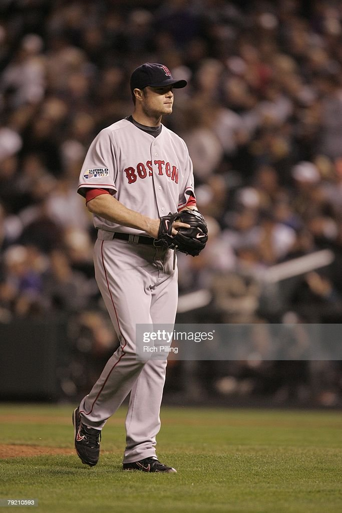 Jon Lester the Boston Red Sox walks off the field during Game Four of the 2007 World Series against the Colorado Rockies on October 28, 2007 at Coors Field in Denver, Colorado. The Red Sox defeated the Rockies 4-3.