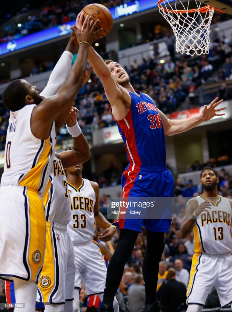 Jon Leuer #30 of the Detroit Pistons battles for the rebound against C.J. Miles #0 of the Indiana Pacers at Bankers Life Fieldhouse on March 8, 2017 in Indianapolis, Indiana.