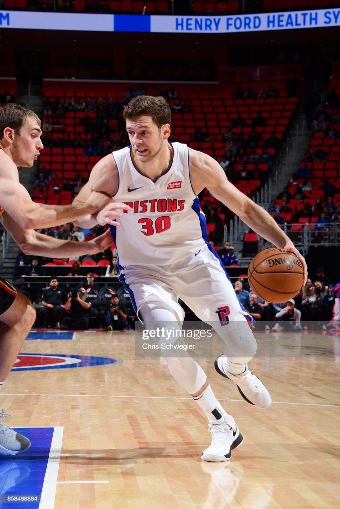 Jon Leuer #30 of the Detroit Pistons handles the ball against the Atlanta Hawks on October 6, 2017 at Little Caesars Arena in Detroit, Michigan.
