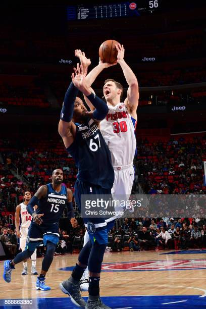 Jon Leuer of the Detroit Pistons shoots the ball against the Minnesota Timberwolves on October 25 2017 at Little Caesars Arena in Detroit Michigan...