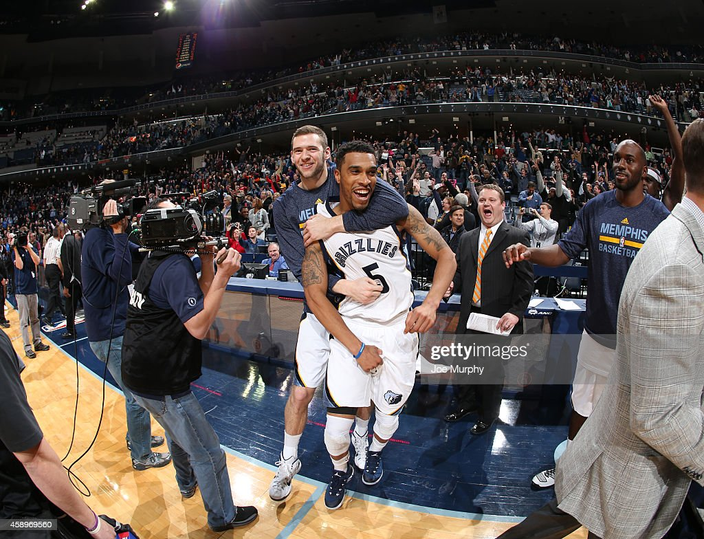 Jon Leuer of the Memphis Grizzlies congratulates and celebrates with Courtney Lee after he hit the winning shot against the Sacramento Kings on...