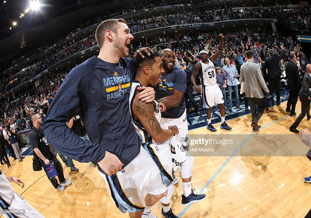 <a gi-track='captionPersonalityLinkClicked' href=/galleries/search?phrase=Jon+Leuer&family=editorial&specificpeople=4630766 ng-click='$event.stopPropagation()'>Jon Leuer</a> #30 of the Memphis Grizzlies congratulates and celebrates with <a gi-track='captionPersonalityLinkClicked' href=/galleries/search?phrase=Courtney+Lee&family=editorial&specificpeople=730223 ng-click='$event.stopPropagation()'>Courtney Lee</a> #5 after he hit the winning shot against the Sacramento Kings on November 13, 2014 at FedExForum in Memphis, Tennessee.