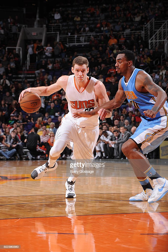 Jon Leuer #30 of the Phoenix Suns drives against the Denver Nuggets on December 23, 2015, at Talking Stick Resort Arena in Phoenix, Arizona.