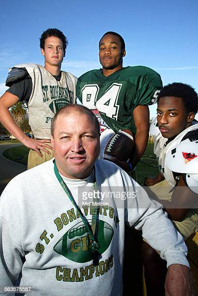 Jon Mack head football coach of St Bonaventure HS varsity football team in Ventura with players from left– quarterback Brian Stevens senior defensive...
