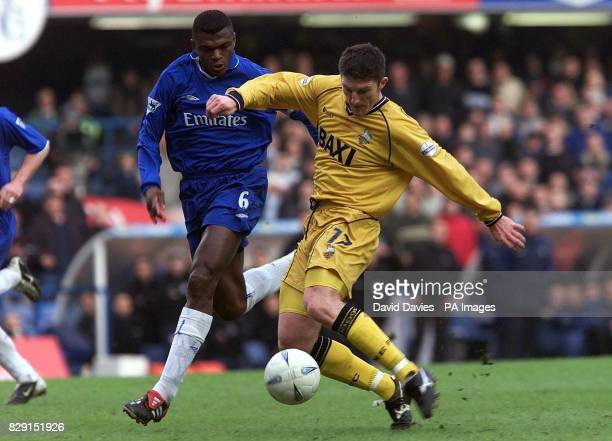Jon Macken of Preston shoots under pressure from Marcel Desailly of Chelsea during Chelsea v Preston's AXA FA Cup Fifth Round match at Stamford...