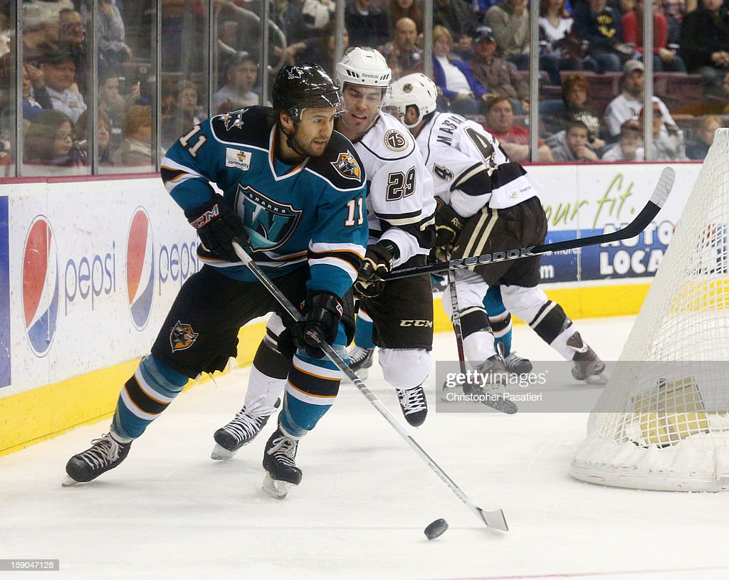 Jon Matsumoto #11 of the Worcester Sharks is challenged for the puck by Julien Brouillette #29 of the Hershey Bears during an American Hockey League game on January 6, 2013 at the Giant Center in Hershey, Pennsylvania.