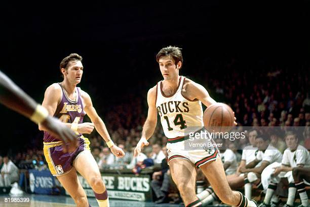 Jon McGlocklin of the Milwaukee Bucks moves the ball up court during a game against the Los Angeles Lakers in the 1970 season at the MECCA Arena in...