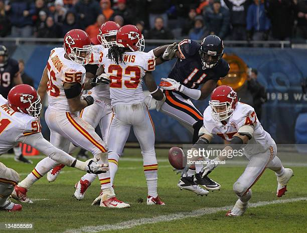 Jon McGraw of the Kansas City Chiefs intercepts a pass intended for Roy Williams of the Chicago Bears that was batted around by teammates including...