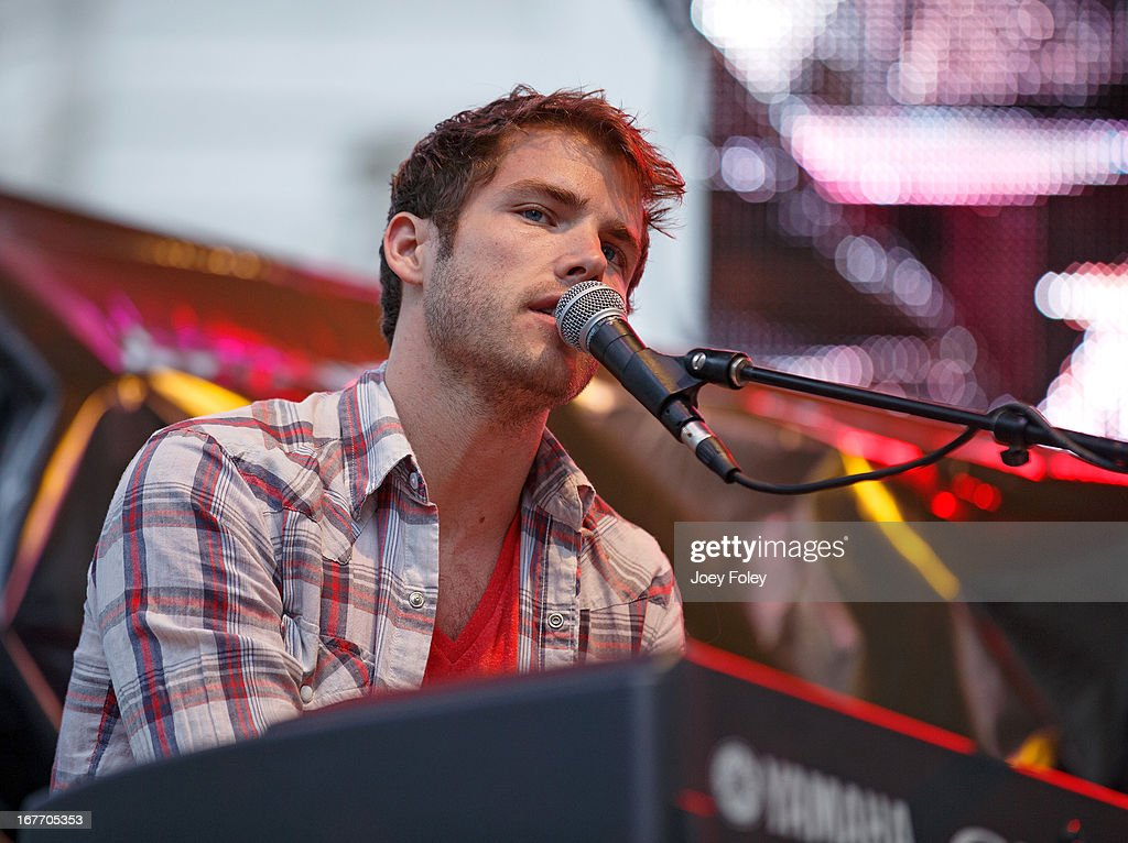Jon McLaughlin performs onstage in the rain during the 2013 500 Festival REV Your Engines Concert at Monument Circle on April 27, 2013 in Indianapolis, Indiana.