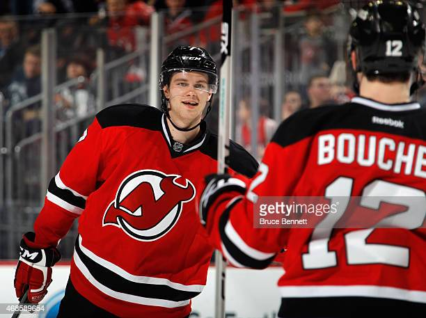Jon Merrill of the New Jersey Devils congratulates Reid Boucher on his second period goal against the Montreal Canadiens at the Prudential Center on...